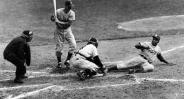Jackie Robinson steals home plate during Game 1 of the 1955 World Series