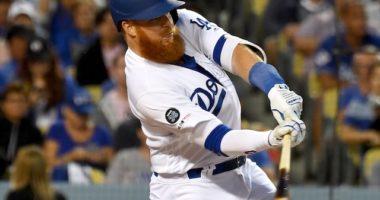 Los Angeles Dodgers third baseman Justin Turner hits his 100th career home run