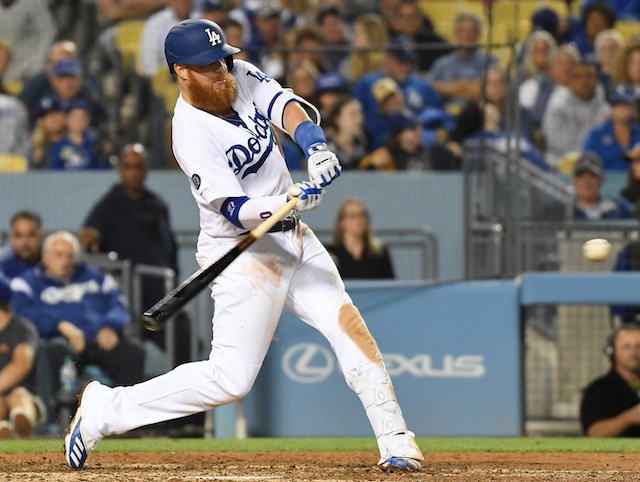 Los Angeles Dodgers third baseman Justin Turner hits a double against the San Francisco Giants