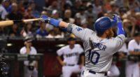 Los Angeles Dodgers third baseman Justin Turner hits a home run against Arizona Diamondbacks starting pitcher Robbie Ray