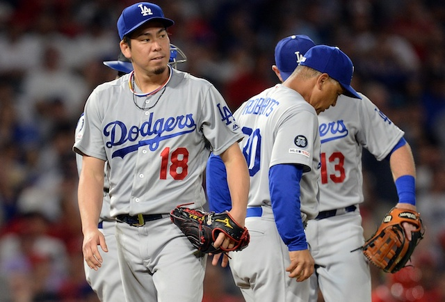 Los Angeles Dodgers manager Dave Roberts removes starting pitcher Kenta Maeda from a game against the Los Angeles Angels of Anaheim