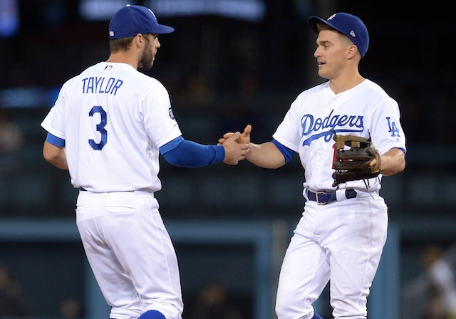 Kiké Hernandez and Chris Taylor celebrate after a Los Angeles Dodgers win at Dodger Stadium