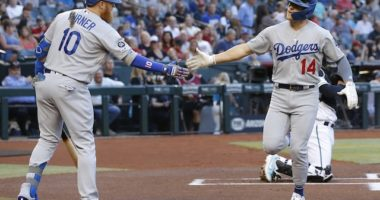 Los Angeles Dodgers second baseman Kiké Hernandez celebrates with Justin Turner after hitting a home run off Robbie Ray