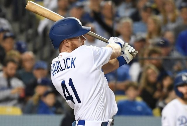 Los Angeles Dodgers outfielder Kyle Garlick hits an RBI single against the San Francisco Giants