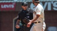 San Francisco Giants starting pitcher Madison Bumgarner talks with home-plate umpire Will Little