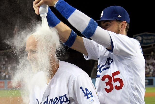 Los Angeles Dodgers teammates Cody Bellinger and Matt Beaty celebrate after a walk-off home run against the Colorado Rockies