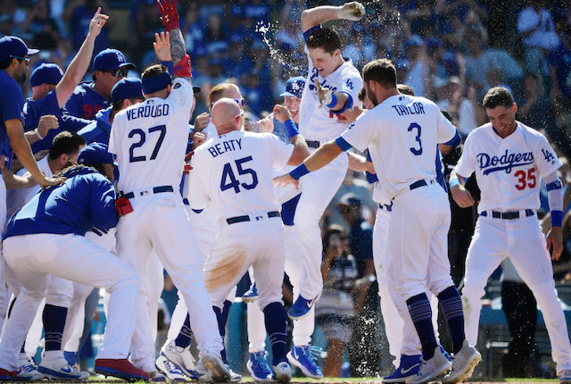 Matt Beaty, Cody Bellinger, Chris Taylor and Alex Verdugo celebrate after a Los Angeles Dodgers walk-off win