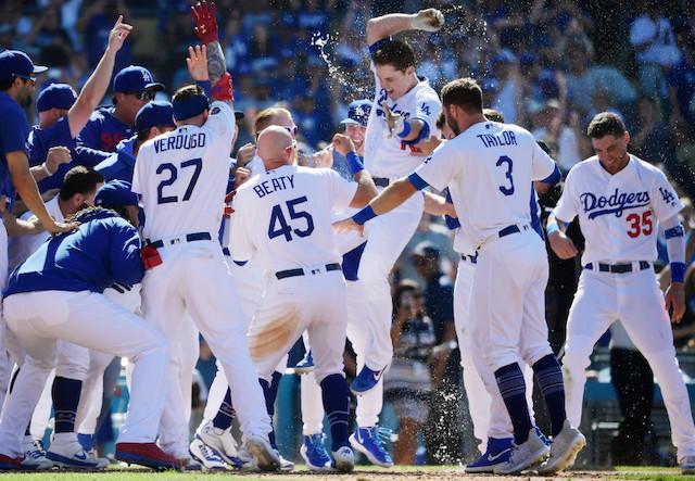 Matt Beaty, Cody Bellinger, Chris Taylor and Alex Verdugo celebrate after a Los Angeles Dodgers walk-off win