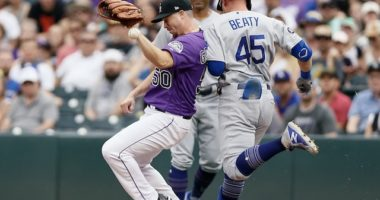 Los Angeles Dodgers infielder Matt Beaty makes it safely to first base against the Colorado Rockies