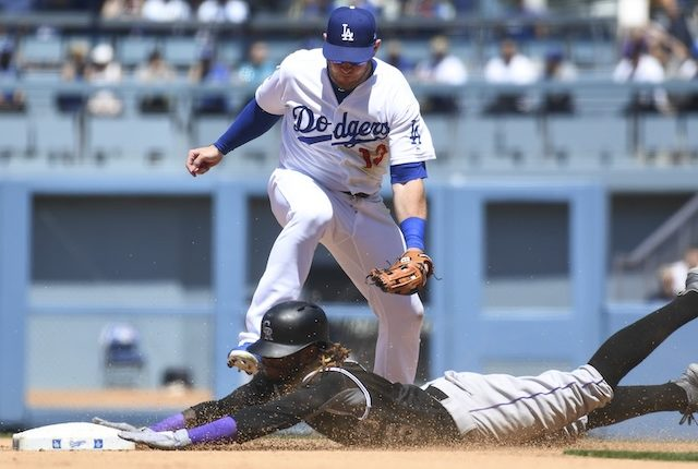 Los Angeles Dodgers infielder Max Muncy fields a throw to second base
