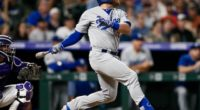 Los Angeles Dodgers infielder Max Muncy hits a home run against the Colorado Rockies