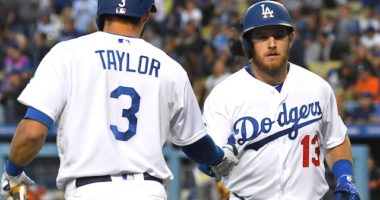 Los Angeles Dodgers shortstop Chris Taylor congratulates Max Muncy after a home run