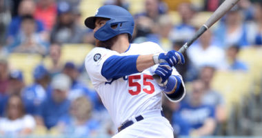 Los Angeles Dodgers catcher Russell Martin hits a single
