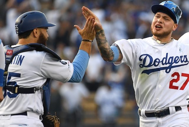 Russell Martin and Alex Verdugo celebrate after the Los Angeles Dodgers defeat the Chicago Cubs