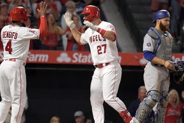 Los Angeles Dodgers catcher Russell Martin looks on after Los Angels Angels of Anaheim center fielder Mike Trout hit a home run