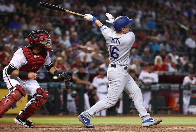 Los Angeles Dodgers catcher Will Smith hits a home run against the Arizona Diamondbacks
