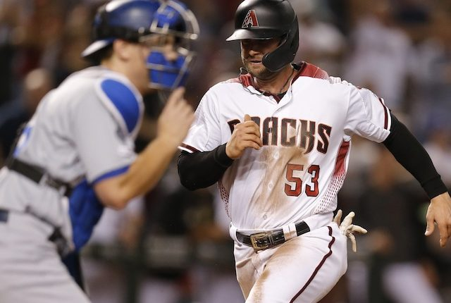 Los Angeles Dodgers catcher Will Smith waits for a throw against the Arizona Diamondbacks