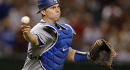 Los Angeles Dodgers catcher Will Smith makes a throw to first base