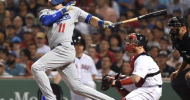 Los Angeles Dodgers center fielder A.J. Pollock hits an RBI single against the Boston Red Sox