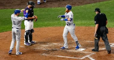 Los Angeles Dodgers teammates A.J. Pollock and Justin Turner celebrate after a home run against the Colorado Rockies