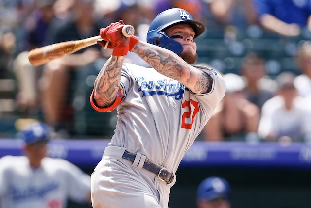 Los Angeles Dodgers outfielder Alex Verdugo hits a double against the Colorado Rockies