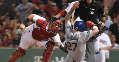 Los Angeles Dodgers outfielder Alex Verdugo is thrown out at home plate against the Boston Red Sox