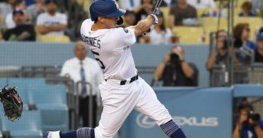 Los Angeles Dodgers catcher Austin Barnes hits a double against the Arizona Diamondbacks