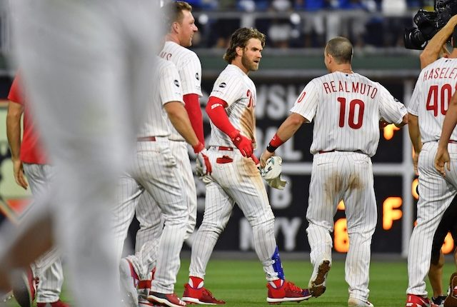 Philadelphia Phillies teammates Bryce Harper and J.T. Realmuto celebrate after a walk-off win against the Los Angeles Dodgers