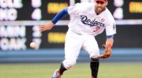 Los Angeles Dodgers shortstop Chris Taylor fields a ground ball