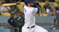 Los Angeles Dodgers shortstop Chris Taylor hits a triple against the Arizona Diamondbacks