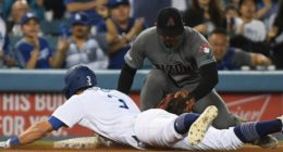 Los Angeles Dodgers shortstop Chris Taylor slides into third base on a triple against the Arizona Diamondbacks