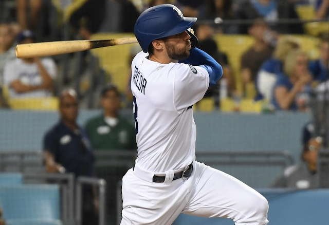 Los Angeles Dodgers shortstop Chris Taylor hits a triple against the Arizona Diamondbacks