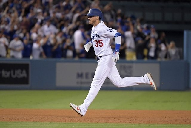Los Angeles Dodgers right fielder Cody Bellinger rounds the bases after hitting a walk-off home run against the Arizona Diamondbacks