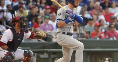 Los Angeles Dodgers right fielder Cody Bellinger hits an RBI single against the Washington Nationals