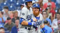 Los Angeles Dodgers teammates Cody Bellinger and Justin Turner celebrate after a home run at Citizens Bank Park