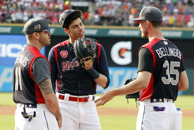 Los Angeles Dodgers right fielder Cody Bellinger and Milwaukee Brewers teammates Mike Moustakas and Christian Yelich speak during a 2019 All-Star Game workout at Progressive Field