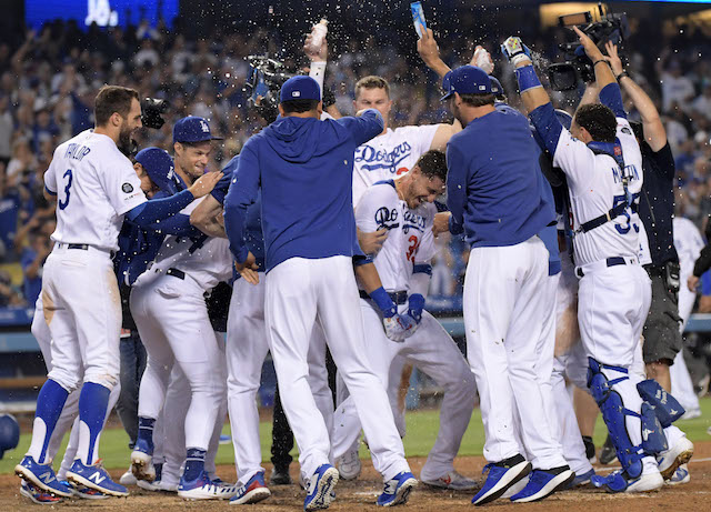 Cody Bellinger, Russell Martin, Joc Pederson, Corey Seager and Chris Taylor celebrate after a Los Angeles Dodgers walk-off win