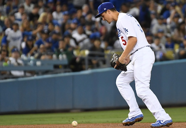 Los Angeles Dodgers shortstop Corey Seager commits an error against the Miami Marlins