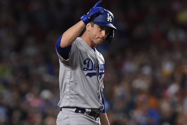 Los Angeles Dodgers first baseman David Freese celebrates after hitting a double against the Boston Red Sox