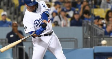 Los Angeles Dodgers first baseman David Freese swings for a pinch-hit single