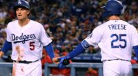 Los Angeles Dodgers teammates David Freese and Corey Seager celebrate during a game against the Cincinnati Reds
