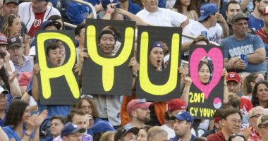 Los Angeles Dodgers fans hold a Hyun-Jin Ryu sign