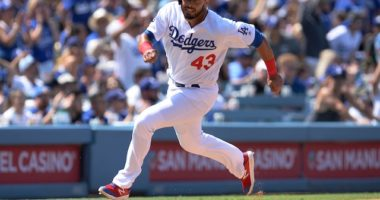 Los Angeles Dodgers infielder Edwin Rios runs toward home plate at Dodger Stadium