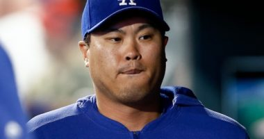 Los Angeles Dodgers starting pitcher Hyun-Jin Ryu in the dugout at Coors Field