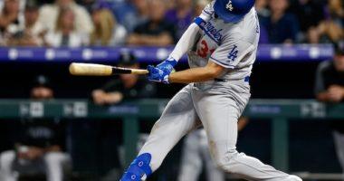 Los Angeles Dodgers outfielder Joc Pederson drives a run in on a groundout