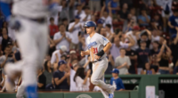 Los Angeles Dodgers outfielder Joc Pederson scores a run on a bases-loaded walk