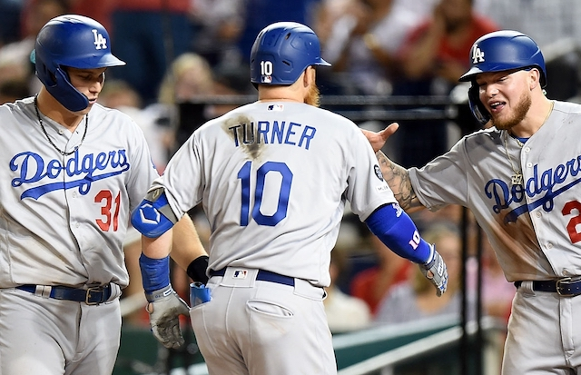 Los Angeles Dodgers teammates Joc Pederson, Justin Turner and Alex Verdugo celebrate after a home run against the Washington Nationals