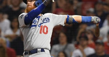 Los Angeles Dodgers third baseman Justin Turner hits a double against the Boston Red Sox