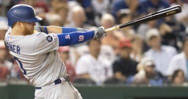 Los Angeles Dodgers third baseman Justin Turner hits a home run against the Washington Nationals