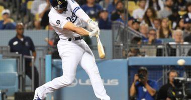Los Angeles Dodgers second baseman Kiké Hernandez hits a ground ball